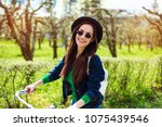 cheerful modern hipster... | Shutterstock . vector #1075439546