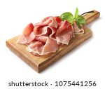 prosciutto on wooden cutting... | Shutterstock . vector #1075441256