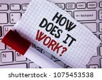 Conceptual hand writing showing How Does It Work Question. Business photo text asking about device or machine operation Tutorial written on Tear Notebook paper placed on the Laptop Marker next to it..