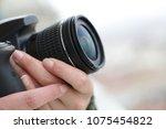 a hand holding a modern digital ... | Shutterstock . vector #1075454822
