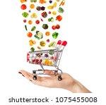 female hand holding grocery... | Shutterstock . vector #1075455008