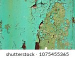 green wall with peeled paint... | Shutterstock . vector #1075455365