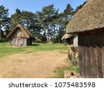 Stock photo anglo saxon huts at west stow in the sunshine 1075483598