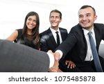 closeup of a business handshake ... | Shutterstock . vector #1075485878