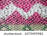 Snake skin background. Multicolored bright exotic animal print skin in red green beige colors