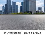 empty road with modern business ... | Shutterstock . vector #1075517825