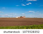 american farmland with blue sky ... | Shutterstock . vector #1075528352