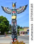 """Small photo of DUNCAN BC CANADA JUNE 22 2015: Totem pole in Duncan's tourism slogan is """"The City of Totems"""". The city has 80 totem poles around the entire town, which were erected in the late 1980s."""