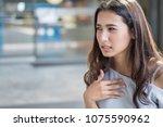 woman suffering from acid... | Shutterstock . vector #1075590962