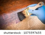 hand holding brush shows how to ... | Shutterstock . vector #1075597655