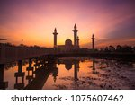 a great sunrise of mosque bukit ... | Shutterstock . vector #1075607462