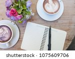 pen and small notebook on wood... | Shutterstock . vector #1075609706