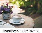 hot latte art in coffee cup on... | Shutterstock . vector #1075609712