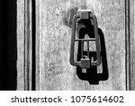 an antique bronze doorknob....   Shutterstock . vector #1075614602
