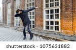 guy teen walking around the... | Shutterstock . vector #1075631882