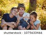 mother and three children in... | Shutterstock . vector #1075633466
