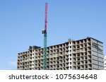 the red construction crane... | Shutterstock . vector #1075634648