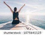 a young girl in a black summer... | Shutterstock . vector #1075641125