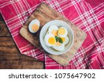 boiled eggs in a bowl decorated ... | Shutterstock . vector #1075647902