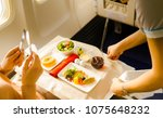 flight attendant serving a... | Shutterstock . vector #1075648232