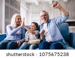 the happy girl and grandparents ... | Shutterstock . vector #1075675238