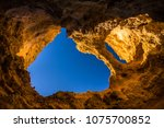 lagos caves and seashore with... | Shutterstock . vector #1075700852