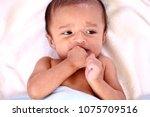 newborn baby self soothing | Shutterstock . vector #1075709516
