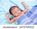 close up of newborn sleeping | Shutterstock . vector #1075709522