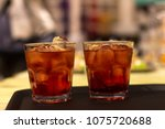 close up on cocktail glasses on ... | Shutterstock . vector #1075720688