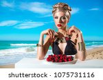 woman in a swimsuit with a... | Shutterstock . vector #1075731116
