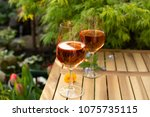two cold rose wine glasses... | Shutterstock . vector #1075735115