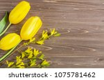 bouquet of yellow tulips and... | Shutterstock . vector #1075781462