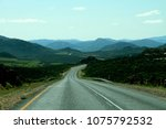 winding road with mountains... | Shutterstock . vector #1075792532