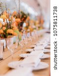 served dinner table in a... | Shutterstock . vector #1075811738