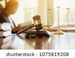 judge gavel with justice ... | Shutterstock . vector #1075819208