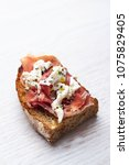 bruschetta with cheese and... | Shutterstock . vector #1075829405