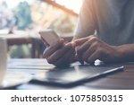 casual man  freelance using... | Shutterstock . vector #1075850315