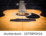 acoustic guitar with music note | Shutterstock . vector #1075893416