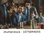 cheerful multiethnic men in...   Shutterstock . vector #1075894055