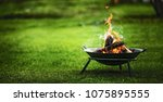 barbecue grill with fire on... | Shutterstock . vector #1075895555