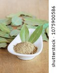 Small photo of Powder of dried bay leaf of the bay tree, used in cooking.
