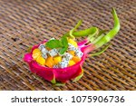 fresh tropical fruit salad in... | Shutterstock . vector #1075906736