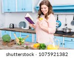 overweight young woman with... | Shutterstock . vector #1075921382