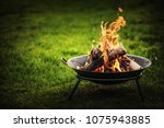 barbecue grill with fire on... | Shutterstock . vector #1075943885