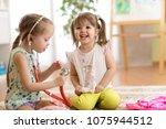 children playing doctor in... | Shutterstock . vector #1075944512