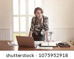 asian business woman working in ... | Shutterstock . vector #1075952918