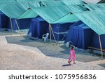 earthquake refugees tent camp...   Shutterstock . vector #1075956836