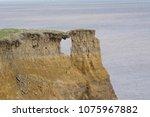 sea cliff erosion at aldborough | Shutterstock . vector #1075967882