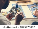 technicians working on computer ... | Shutterstock . vector #1075975082