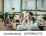 happy family having lunch in a... | Shutterstock . vector #1075981172